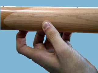 Position du pouce sur le manche